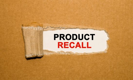 The text Product Recall appearing behind torn brown paper