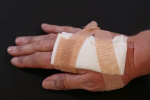 bandage on a hand of a person who is calling a injury attorney newport news