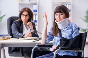 Injured person visiting lawyer for advice with health insurance claim seeking personal injury attorney in smithfield