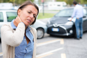 woman feeling pain after car accident, if needing help with uninsured motorist that caused your auto accident contact skilled attorneys in Jamestown