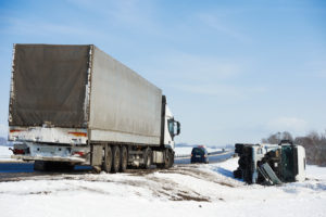 Winter highway accident with a semitruck, if suffering from injuries from an auto accident, contact experienced Newport truck accident lawyer.