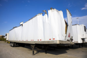 A white truck trailer after an accident representing how Hampton Injury Law can assist you with truck accidents