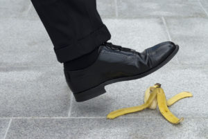 A man about to slip on a banana representing how our personal injury lawyer can assist you with slip and fall accidents