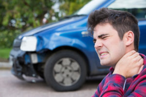 Man hurt after a car accident representing how our law firm can assist you with your personal injury claim