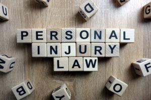 Wooden block letters spelling Personal Injury Lawyers in Jamestown.