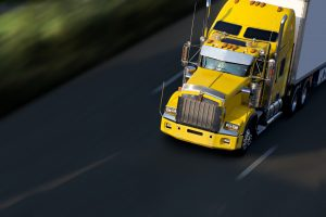 A semi-truck driving on highway, when involved in a collision with a big rig consult with our Truck Accident Attorney Smithfield.