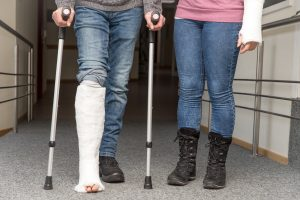 Person with leg in cast with crutches, the Yorktown Personal Injury Lawyer can help with your lawsuit if injured at another's fault.