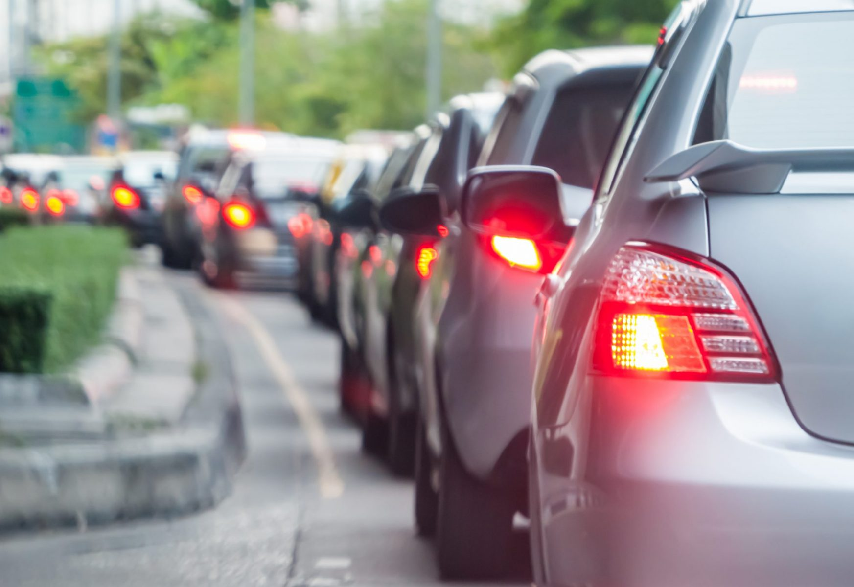 Car lined up in traffic showing how you should consult with a Hampton car accidents attorney.