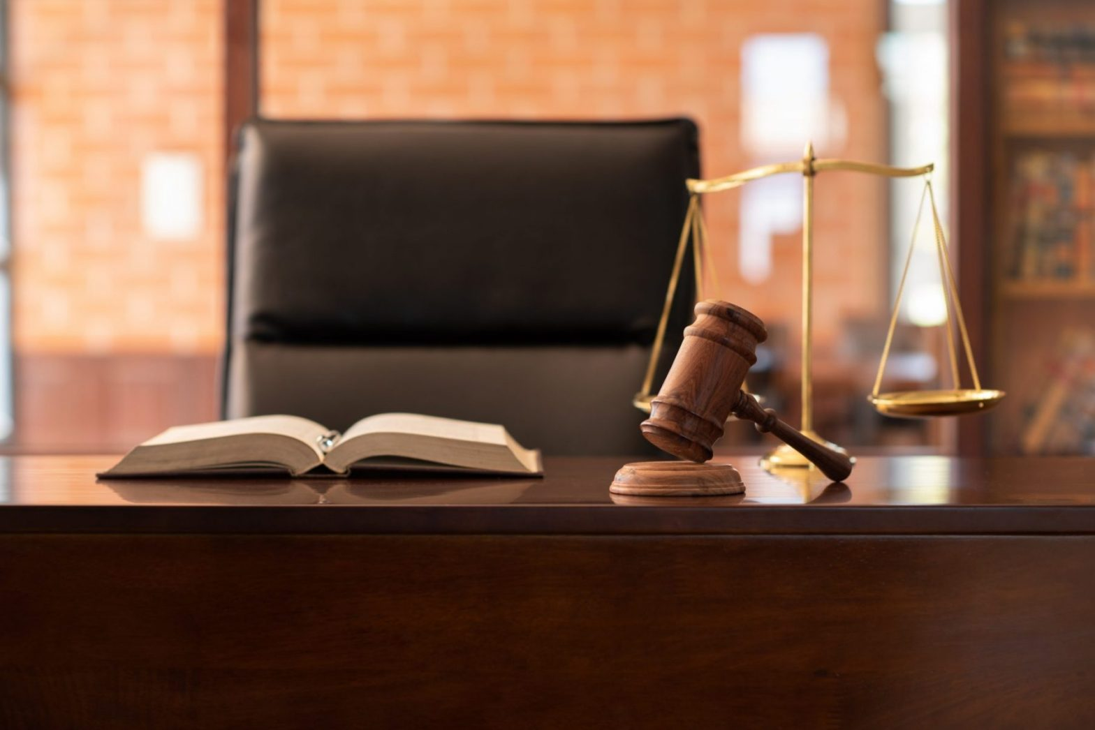A book, gavel and scale on the desk of a Smithfield auto accident attorney.