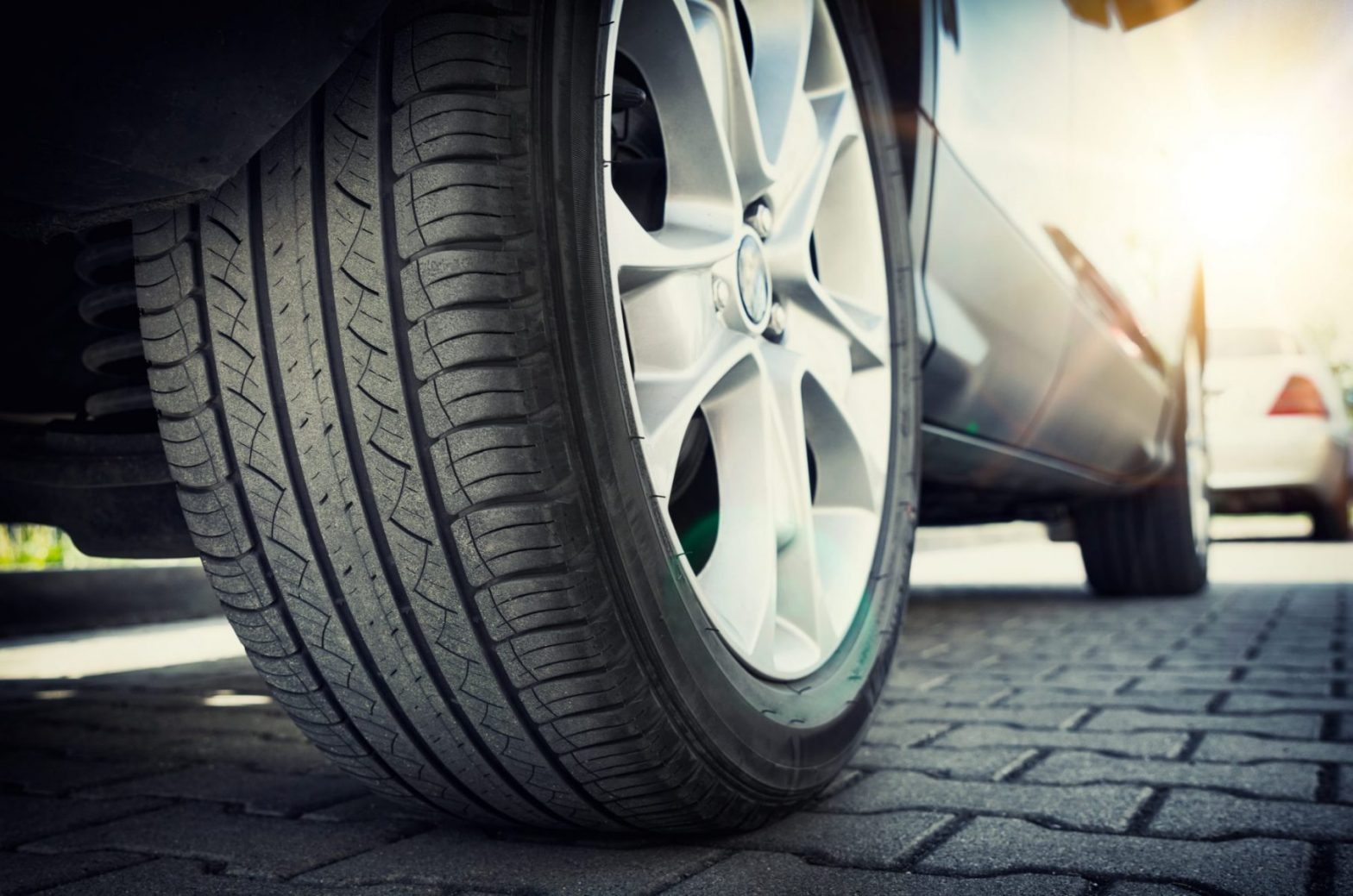 A car tire close up representing how our Hampton car accident attorney can help if you have been injured in a crash